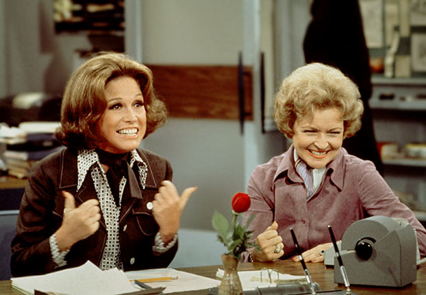 Mary Tyler Moore (as Mary Richards) (left) gives a 'thumbs up' sign as she sits at her desk with Betty White (as Sue Ann Nivens) in a scene from 'The Mary Tyler Moore Show'