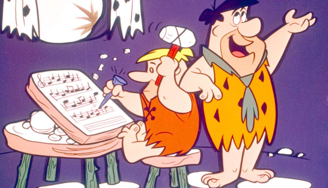 Barney dictándole unas palabras a Fred'