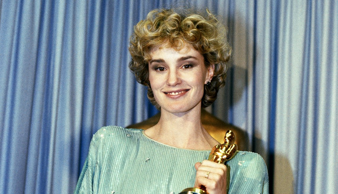 Jessica Lange holding the Oscar that she won for Best Actress in a Supporting Role, for her role in Tootsie