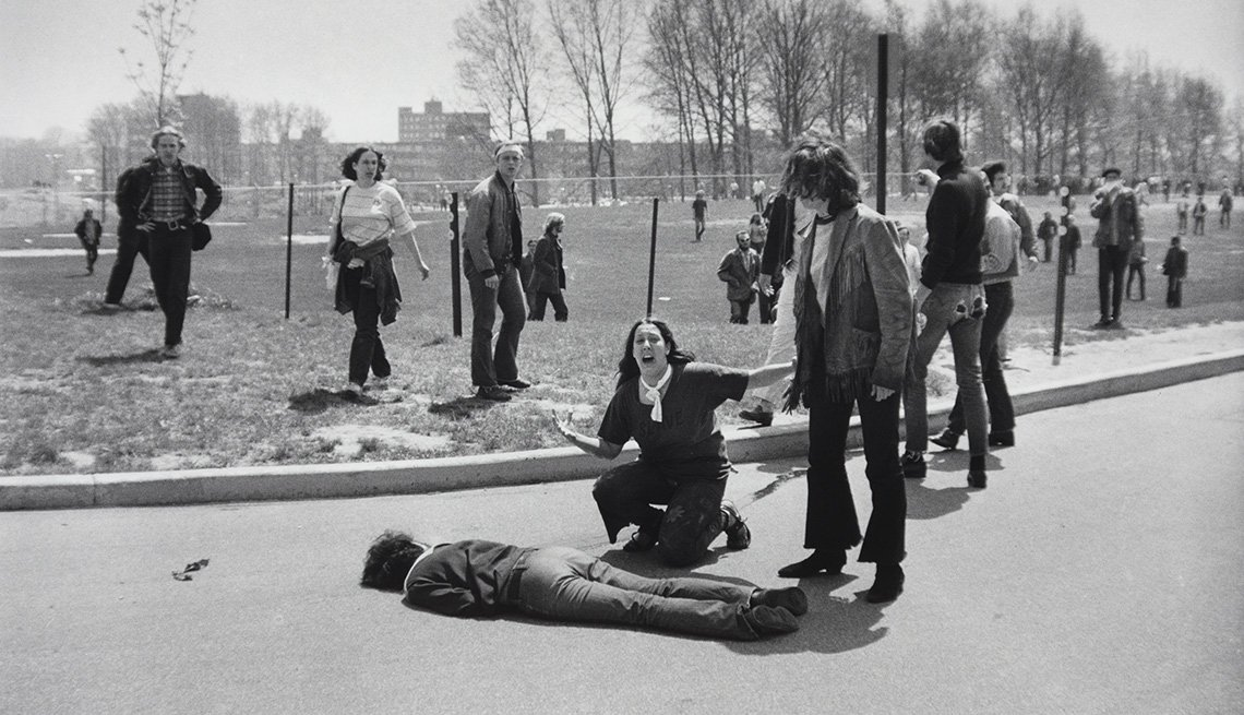 Mary Ann Vecchio kneels over the body of fellow student Jeffrey Miller, who was killed by Ohio National Guard troops during an antiwar demonstration at Kent State University. Ohio, May 4, 1970.