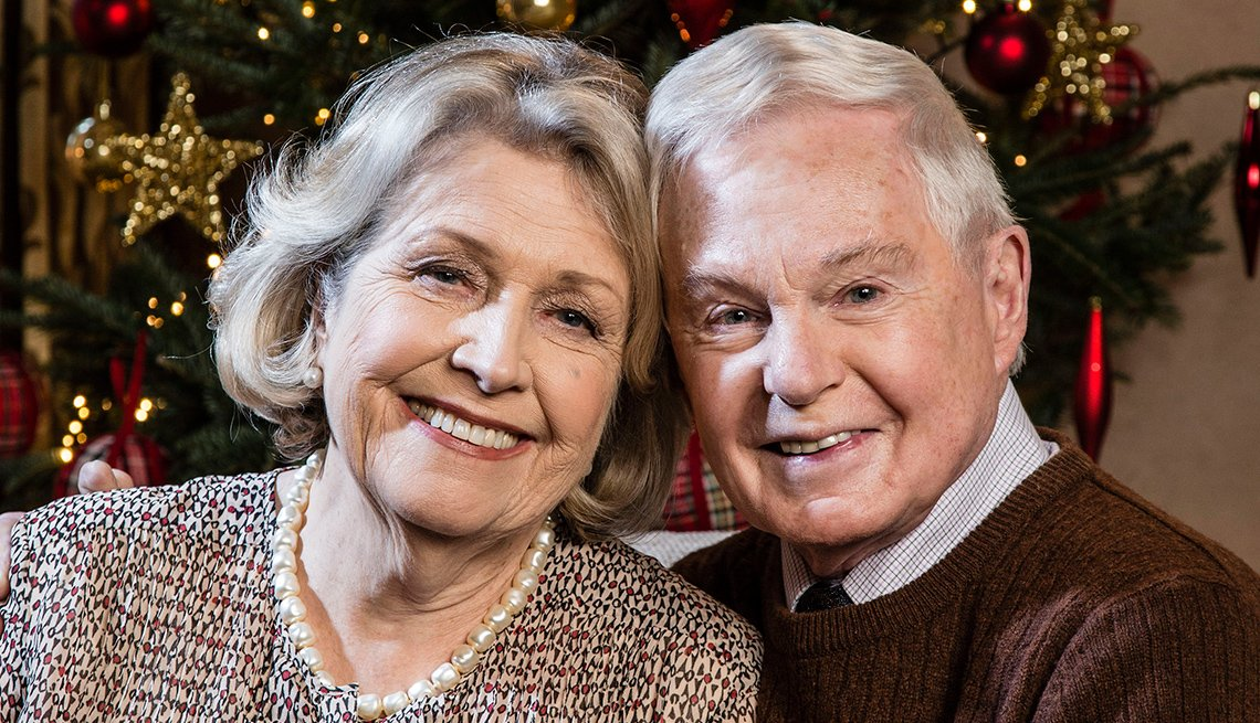 Anne Reid as Celia and Derek Jacobi as Alan mature adults posing for a portrait smiling in 'Last Tango in Halifax'