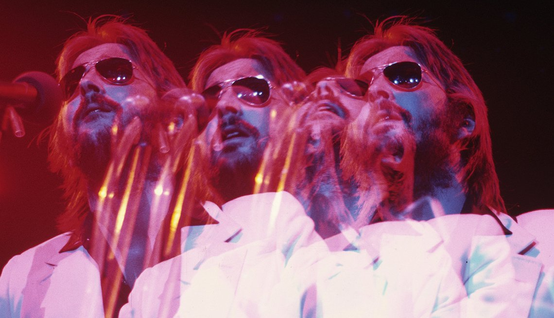 Eric Clapton in 1974, multiple exposure of him singing