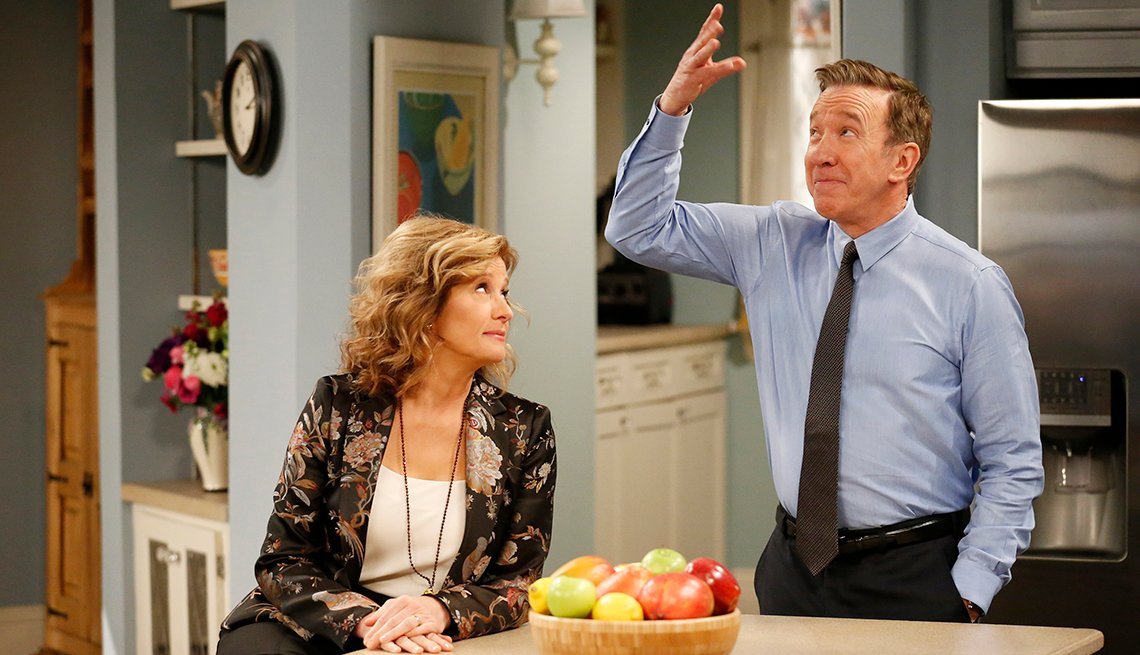 In a scene from 'Last Man Standing,' Nancy Travis looks up to Tim Allen with a puzzled face.