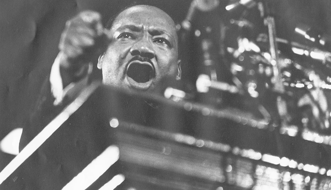 Martin Luther King Jr. standing at a podium