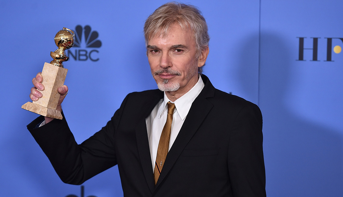 Billy Bob Thornton holding a Golden Globe.
