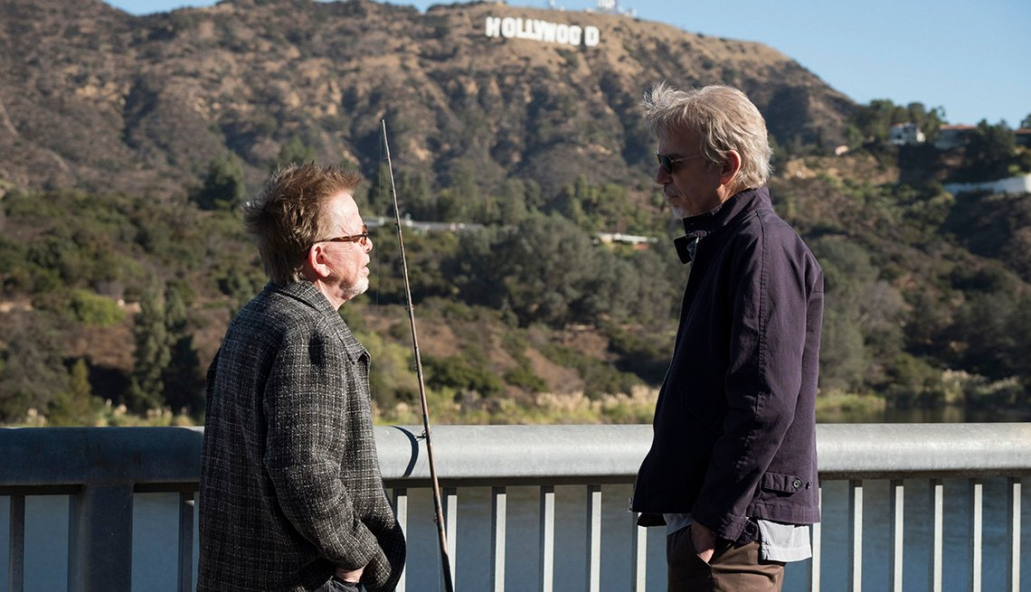 Paul Williams and Billy Bob Thornton standing in front of the Hollywood, California sign.