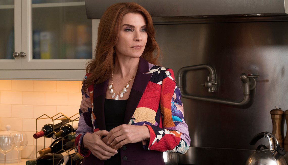 Julianna Margulies standing in a kitchen.