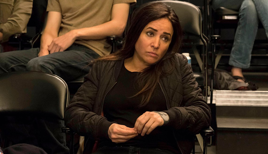 """Pamela Adlon as Sam Fox in a scene from """"Better Things,"""" she's sitting in a chair."""