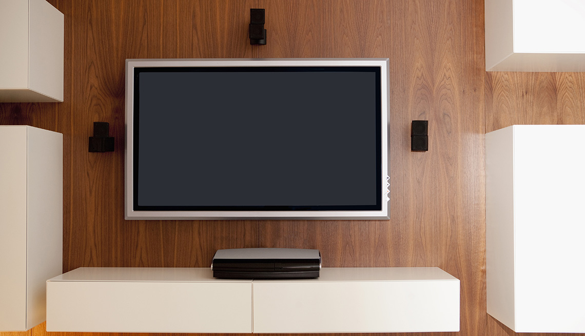 flat screen set up with soundbar and surround sound speakers