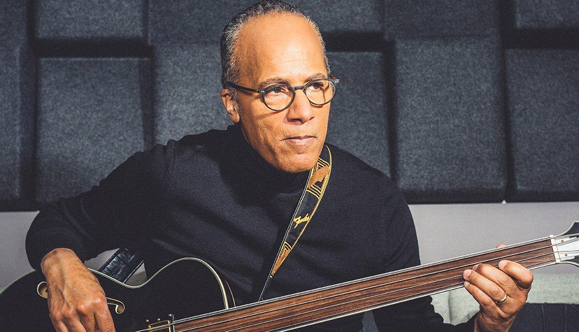 Lester Holt holding a bass.