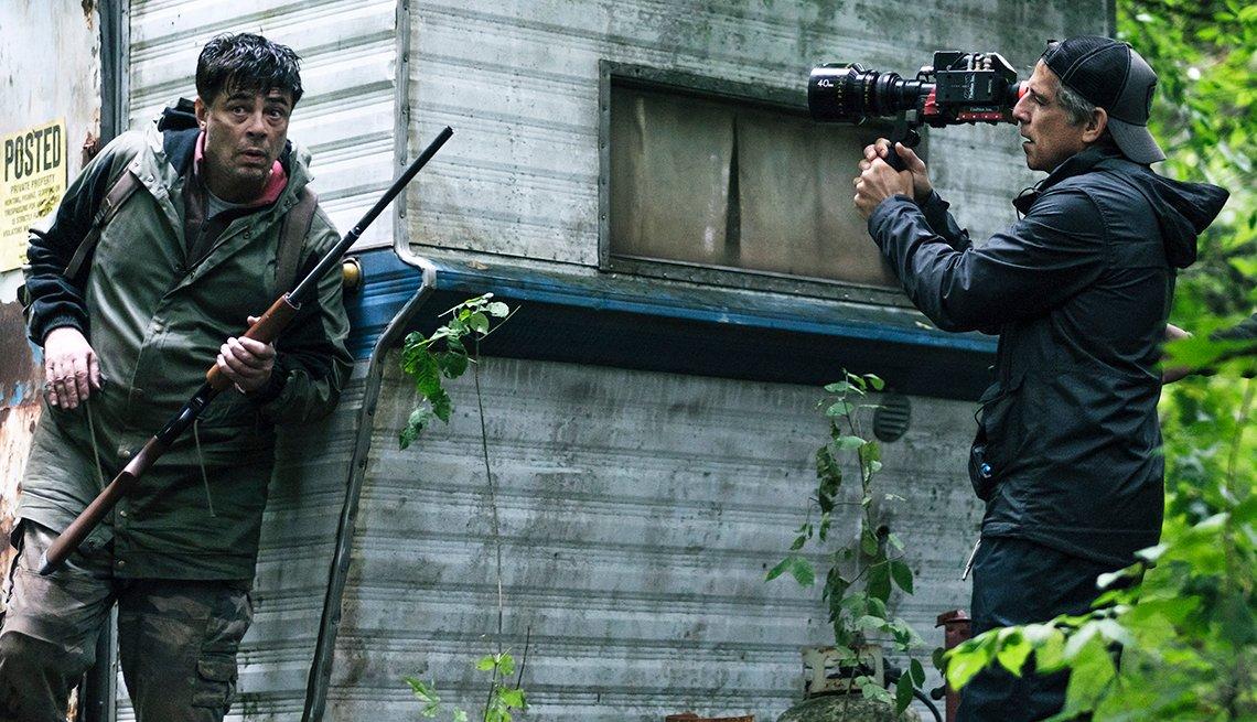 Ben Stiller holding a camera behind the scenes on