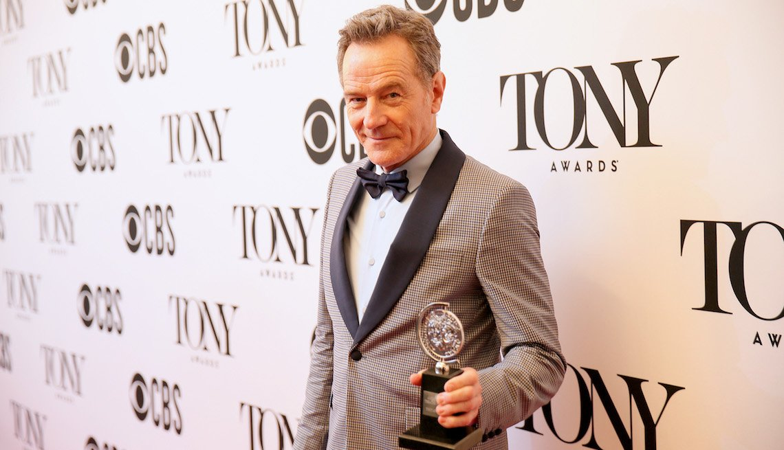 item 1, Gallery image. Bryan Cranston, winner of the award for  Best Performance by an Actor in a Leading Role in a Play for 'Network,' poses in the press room for the 73rd Annual Tony Awards.