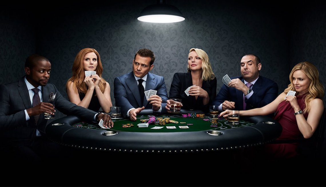 Suits cast playing poker in a promo for season 9