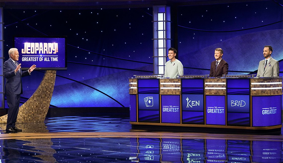 ALEX TREBEK, JAMES HOLZHAUER, KEN JENNINGS, BRAD RUTTER on the set of