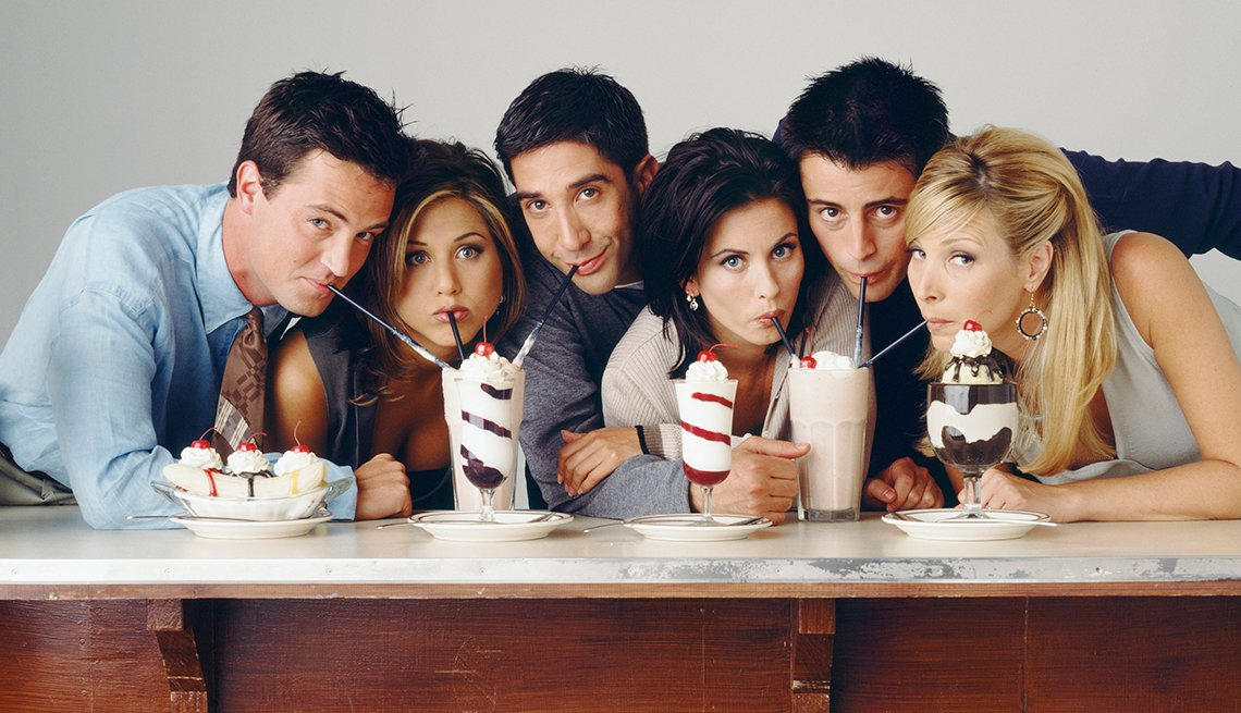 Matthew Perry as Chandler Bing Jennifer Aniston as Rachel Green David Schwimmer as Ross Geller Courteney Cox as Monica Geller Matt LeBlanc as Joey Tribbiani and Lisa Kudrow as Phoebe Buffay drinking milkshakes in a Friends cast photo