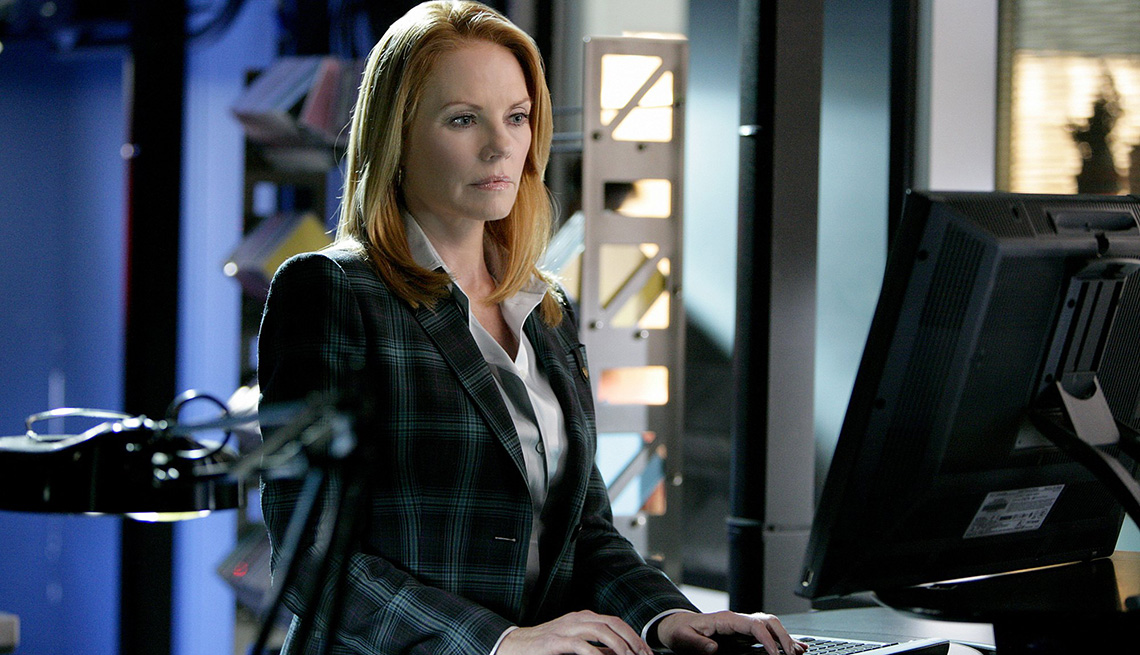 Marg Helgenberger working on a computer as Catherine Willows in the television show C S I