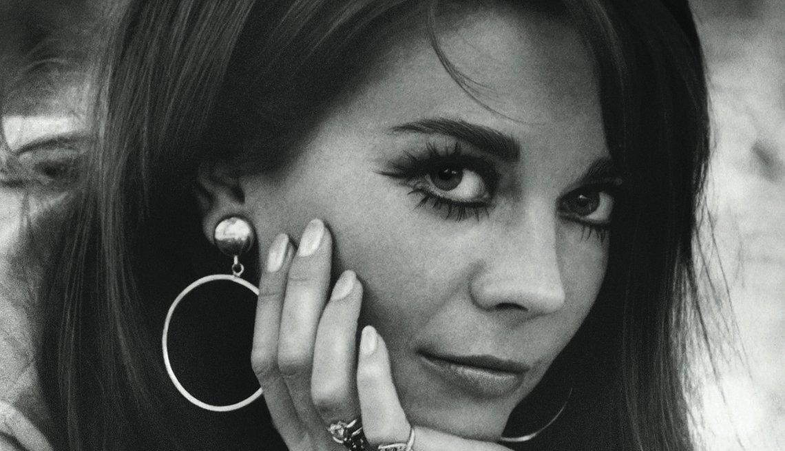 Natalie Wood posing for photo where she places her hand under her chin to hold up her face