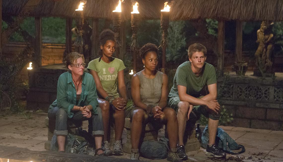 Survivor: Cagayan cast members Kassandra Kass McQuillen J'Tia Taylor Latasha Tasha Fox and Spencer Bledsoe of the Brains Tribe at Tribal Council