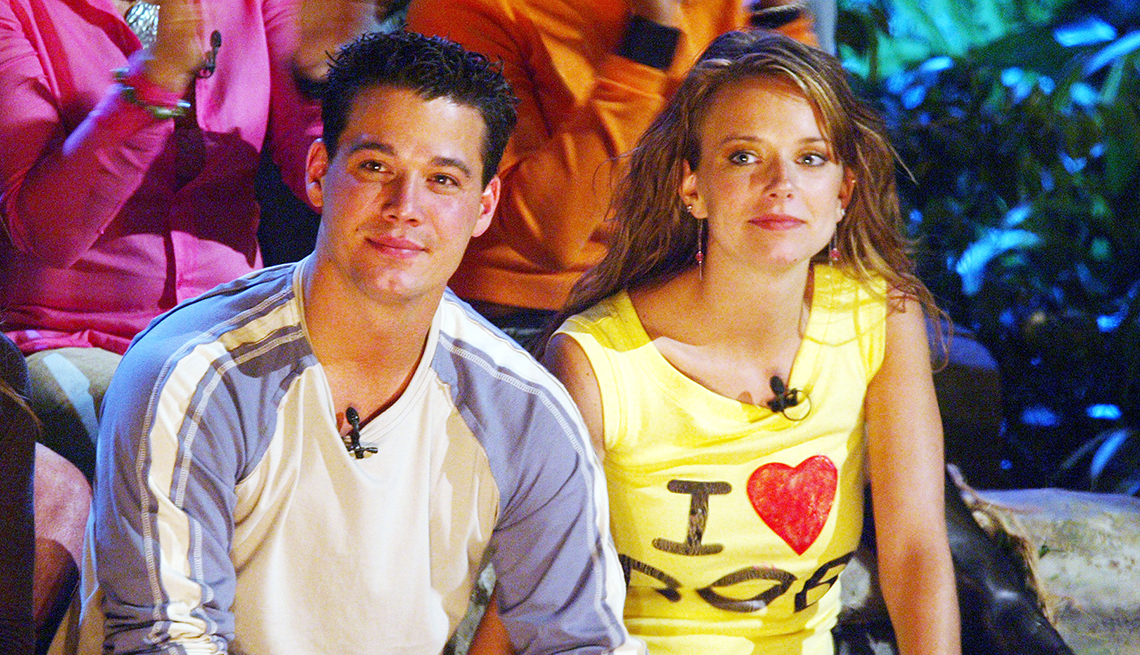 Survivor All Stars cast members Boston Rob Mariano and Amber Brkich sitting next to each other during the season finale