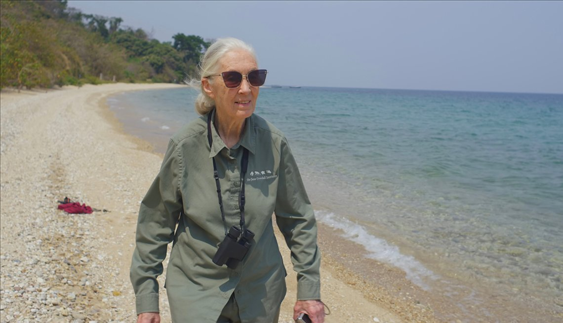 Doctor Jane Goodall walking along the beach of Lake Tanganyika in Africa