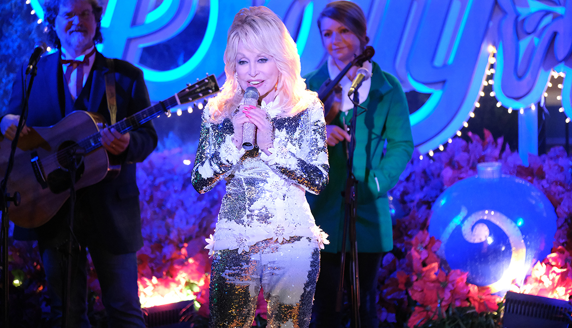 Dolly Parton singing on stage in Christmas at Dollywood