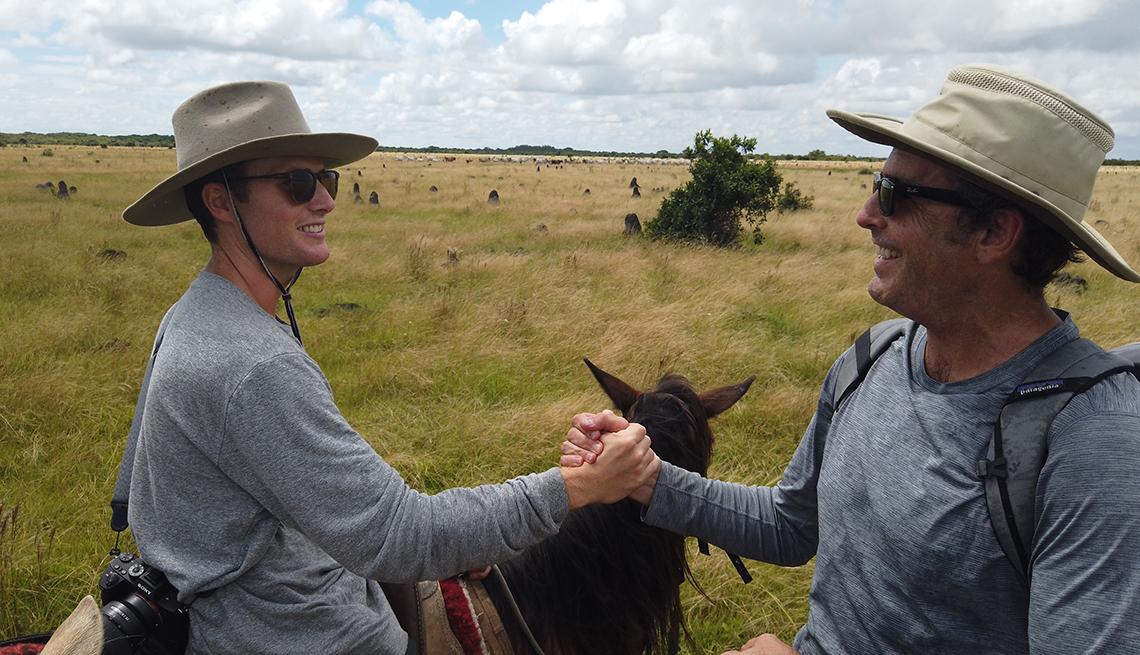 Mack and Bob Woodruff riding horses in Eastern Columbia