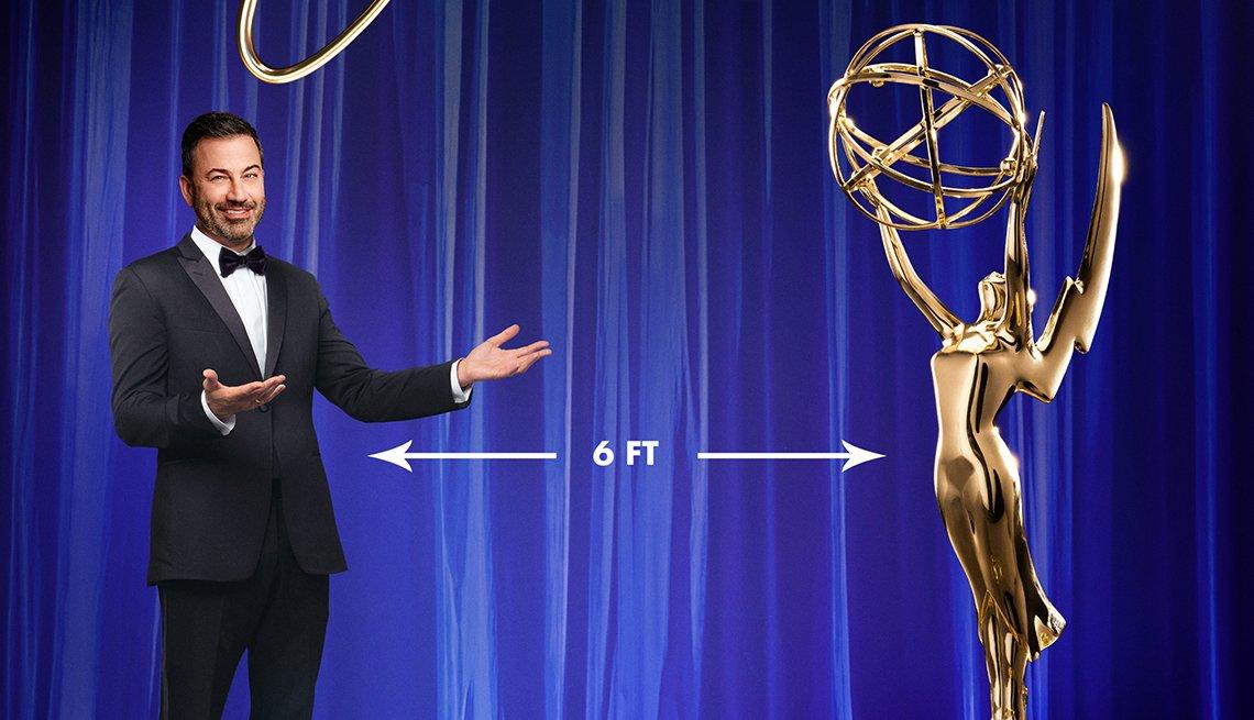 Jimmy Kimmel standing 6 feet away from an Emmy statue