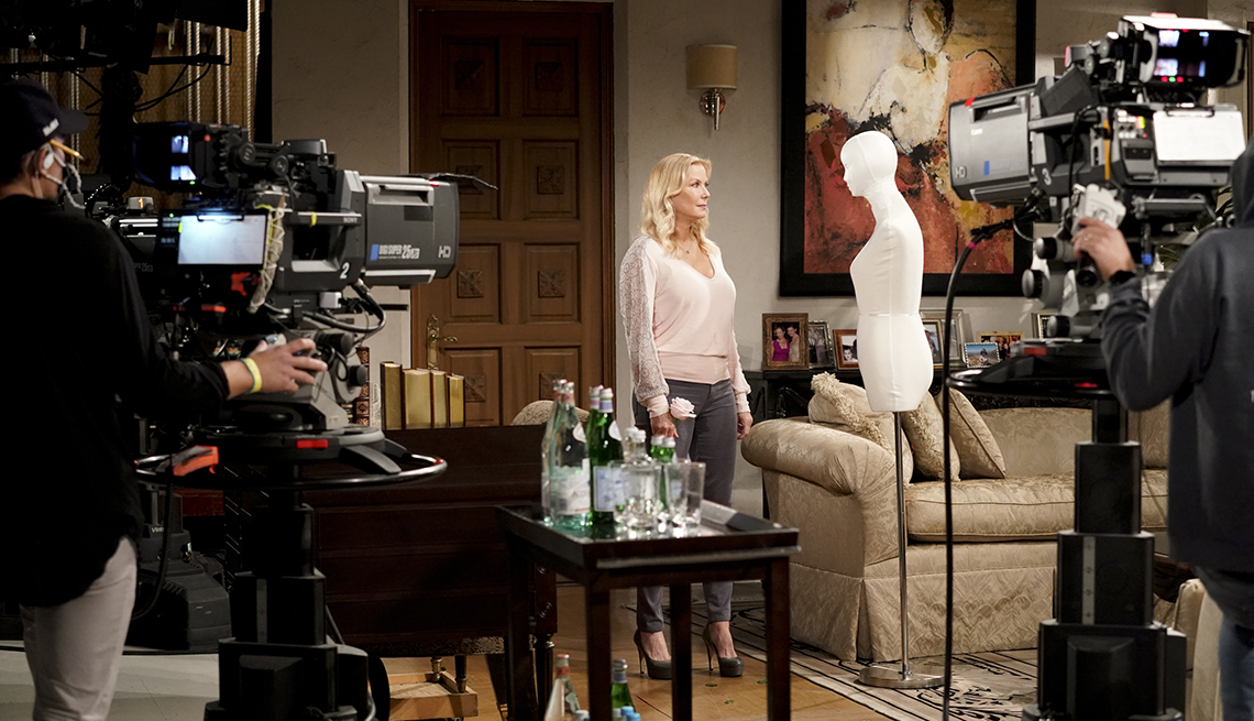 A behind-the-scenes look of Katherine Kelly Lang speaking to a mannequin in the filming of The Bold and the Beautiful