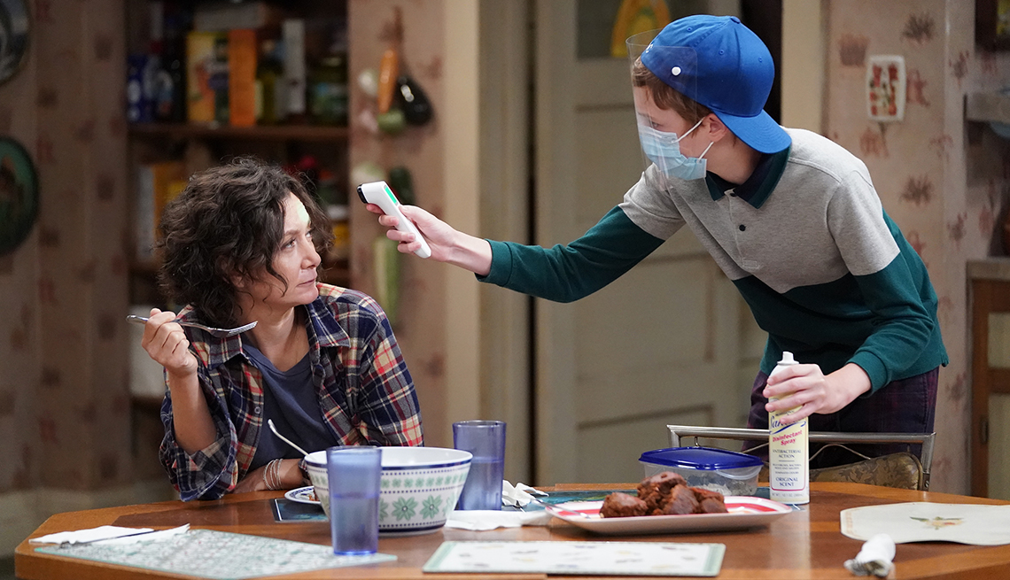 Sara Gilbert and Ames McNamara in a scene from The Conners