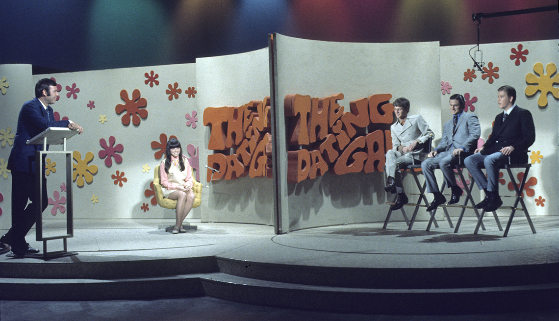 Host Jim Lange with the contestants on The Dating Game