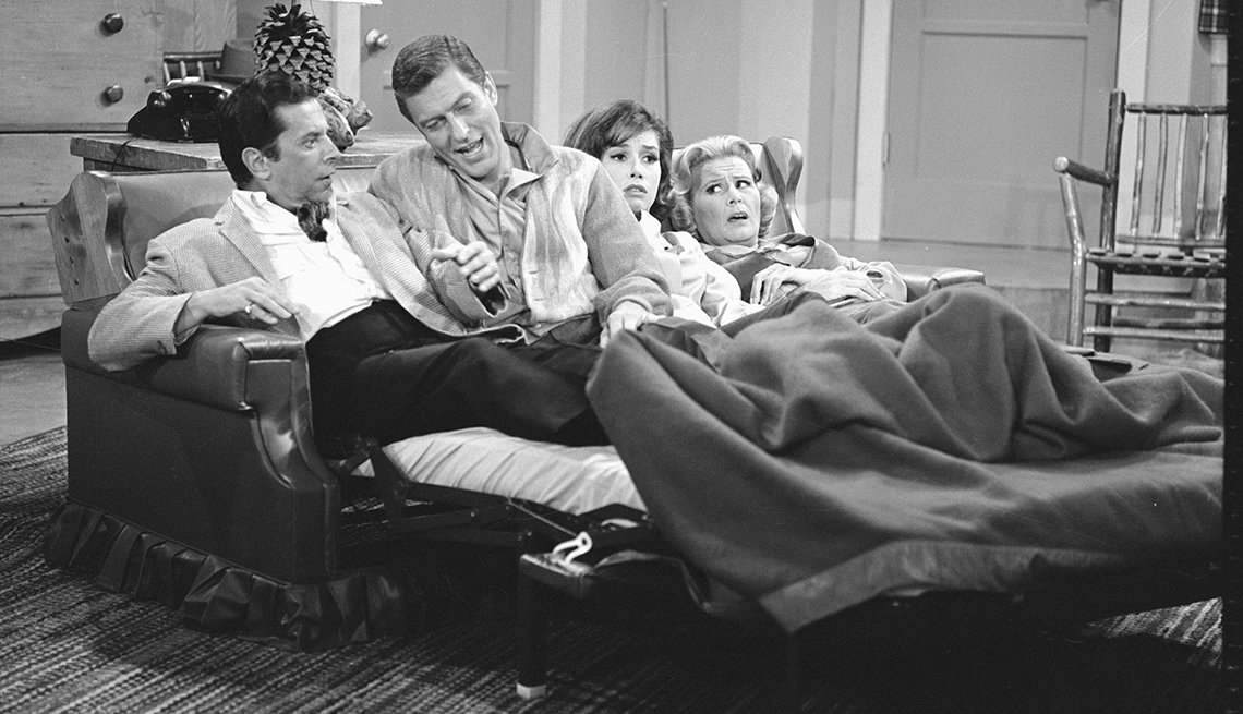 Morey Amsterdam, Dick Van Dyke, Mary Tyler Moore and Rose Marie attempt to share a fold-a-bed in an episode of The Dick Van Dyke Show