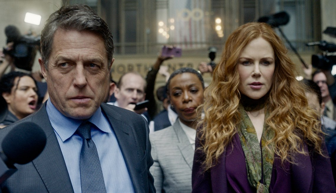 Hugh Grant and Nicole Kidman encounter a crowd of media in a scene from The Undoing