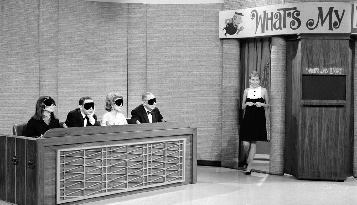 Panelists Phyllis Newman, Frank Sinatra, Arlene Francis and Bennett Cerf are blindfolded as mystery guest Mia Farrow appears on the TV show What's My Line
