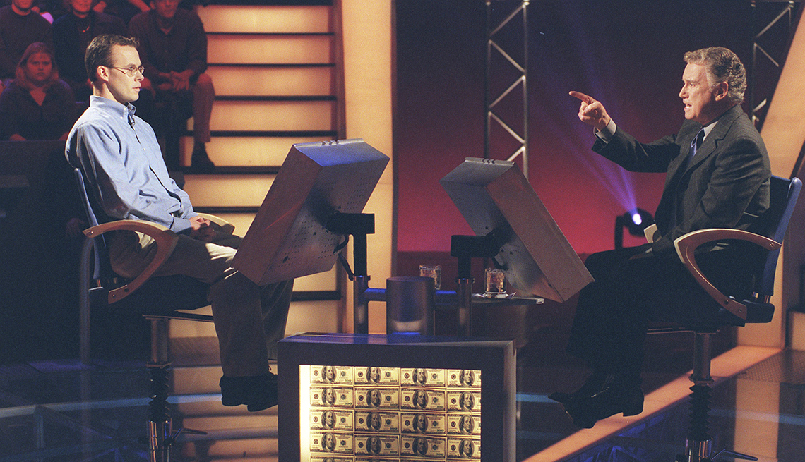 Contestant John Carpenter and host Regis Philbin on the set of Who Wants to be a Millionaire