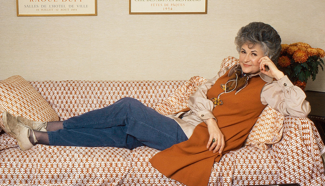Actress Bea Arthur lying on a couch