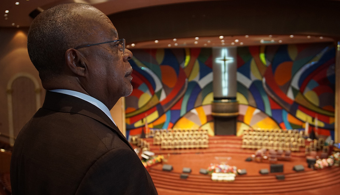 Henry Louis Gates Jr. looks at a mural at the West Angeles Church Of God In Christ