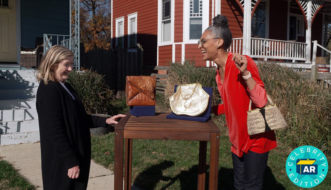 Antiques Roadshow expert Katy Kane and chef Carla Hall with her vintage purse collection