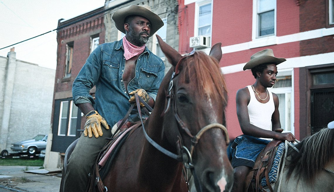 Idris Elba and Caleb McLaughlin in the film Concrete Cowboy