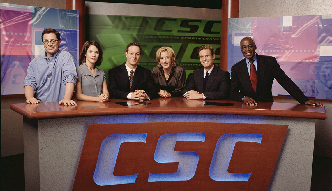A cast photo of Joshua Malina, Sabrina Lloyd, Josh Charles, Felicity Huffman, Peter Krause and Robert Guillaume for the TV show Sports Night