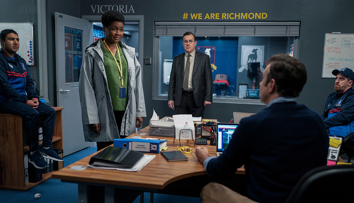 Nick Mohammed, Sarah Niles, Jeremy Swift, Jason Sudeikis and Brendan Hunt in a scene from Season 2 of Ted Lasso