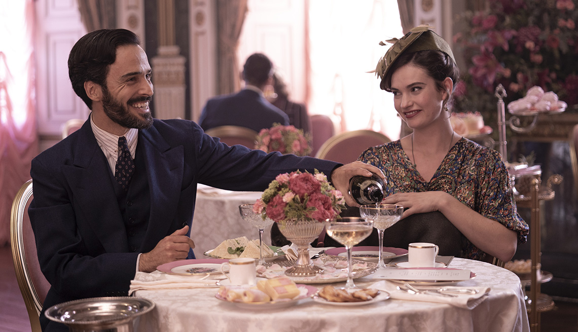 Assaad Bouab and Lily James in a scene from The Pursuit of Love