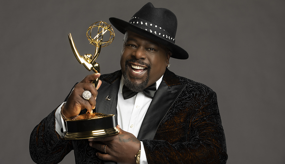 Cedric the Entertainer holds a trophy as he is set to host the 73rd Primetime Emmy Awards