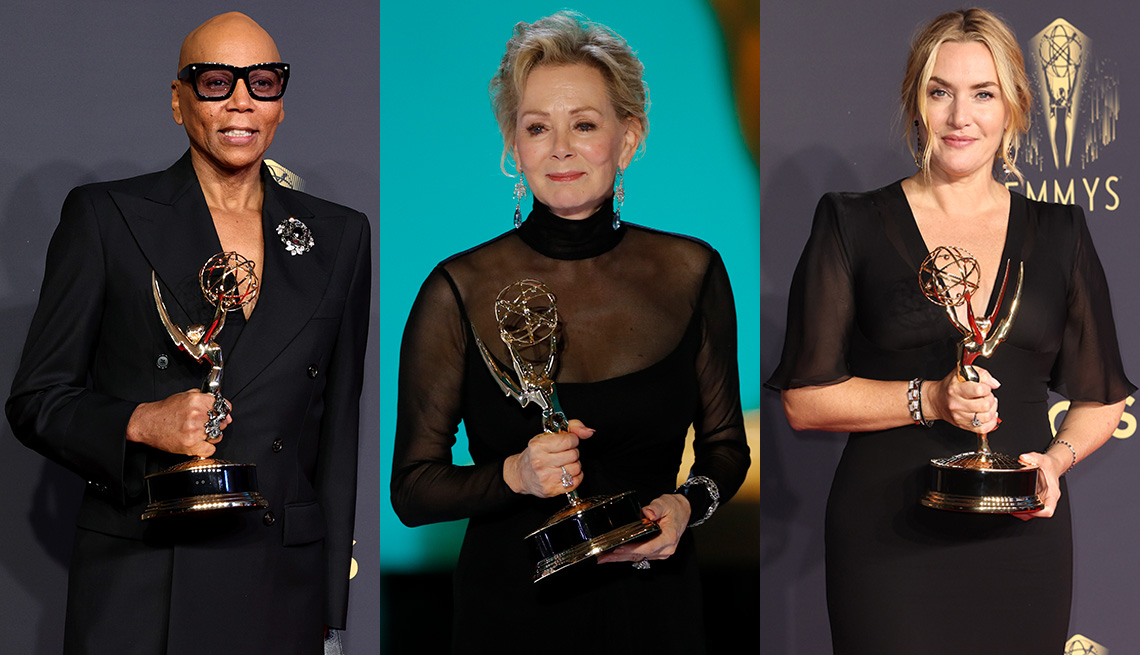 RuPaul, Jean Smart and Kate Winslet each holding their trophies from the 73rd Emmy Awards