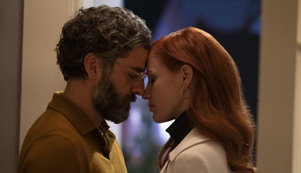 Oscar Issac and Jessica Chastain place their heads against each other during an embrace in the HBO limited series Scenes From a Marriage