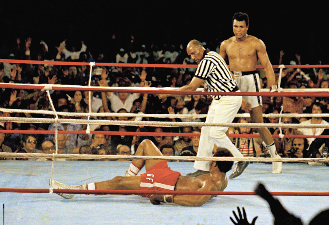 Muhammad Ali knocks down George Foreman during their historic Rumble in the Jungle match in 1974