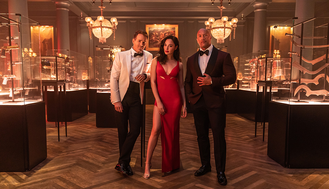 Ryan Reynolds, Gal Gadot and Dwayne The Rock Johnson in the Netflix film Red Notice