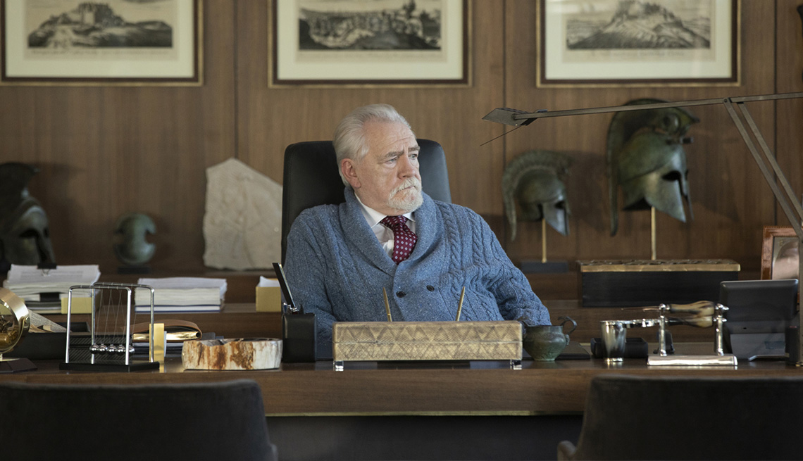 Brian Cox sitting at his office table in the HBO series Succession