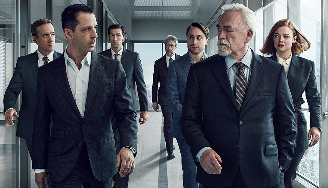 The cast of Succession walking together in a hallway