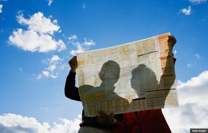 best worst states retire couple holding map sky silhouette