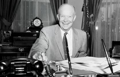 President Dwight Eisenhower president 1957 oval office smiling portrait desk radio